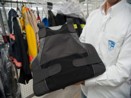 An employee shows a bulletproof vest, which is part of the armoured clothing line produced at the factory of Colombian businessman Miguel Caballero, on the outskirts of Bogota, on December 28, 2012. For 20 years, Miguel Caballero has designed and produced body armour for officers and personalities around the world, …