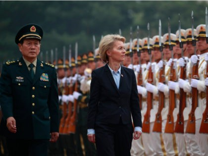 German Defense Minister Ursula von der Leyen (C) and China's Minister of National Defense General Wei Fenghe (L) review honour guards during a military honours ceremony at the Bayi building in Beijing on October 22, 2018. (Photo by HOW HWEE YOUNG / POOL / AFP) (Photo credit should read HOW …