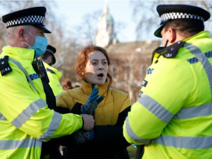 LONDON, ENGLAND - JANUARY 09: A protester is arrested by Police on Clapham Common during the anti-lockdown demonstration on January 9, 2021 in London, England. Chief Medical Officer Chris Whitty has filmed an advert for HM Government warning that people should stay home as the COVID-19 virus is spreading across …