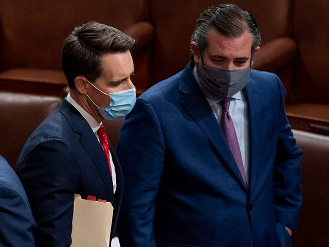 Sen. Josh Hawley, R-Mo., left, and Sen. Ted Cruz, R-Texas, right, speak after Republicans objected to certifying the Electoral College votes from Arizona, during a joint session of the House and Senate to confirm the electoral votes cast in November's election, at the Capitol, Wednesday, Jan 6, 2021. (AP Photo/Andrew …