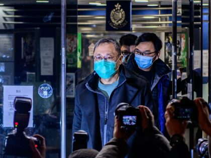 Hong Kong law professor and pro-democracy activist Benny Tai gestures outside Ma On Shan Police station following his release on bail in Hong Kong on January 7, 2021, after his arrest along with dozens of other activists early on January 6 under the city's National Security Law. - More than …