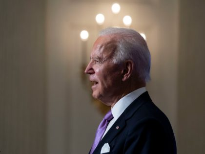 WASHINGTON, DC - JANUARY 26: U.S. President Joe Biden speaks about the coronavirus pandemic in the State Dining Room of the White House on January 26, 2021 in Washington, DC. President Biden said his administration has secured commitments from vaccine makers Pfizer and Moderna to purchase another 200 million doses …