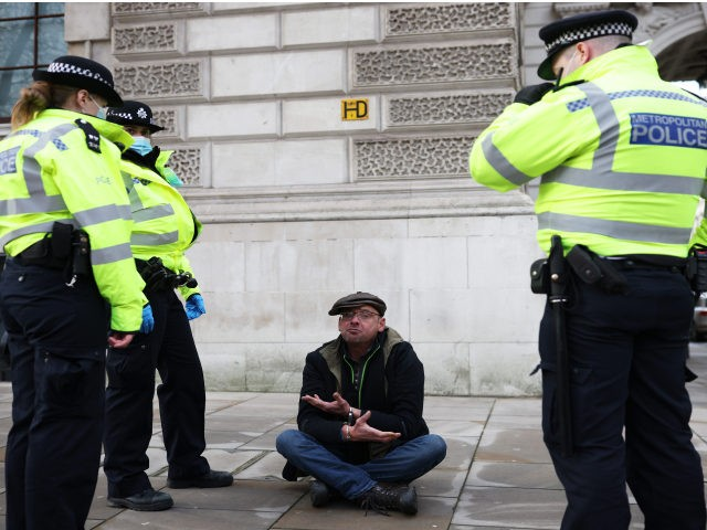 LONDON, ENGLAND - JANUARY 06: An anti-lockdown protester is arrested by police officers in Parliament Square outside the House of Commons on January 6, 2021 in London, England. The UK Parliament has been recalled today to debate and vote on the new regulations needed to reimpose the England-wide lockdown that …