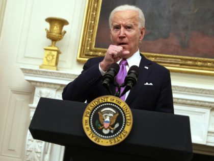 WASHINGTON, DC - JANUARY 21: U.S. President Joe Biden clears his throat as he speaks as Vice President Kamala Harris looks on during an event at the State Dining Room of the White House January 21, 2021 in Washington, DC. President Biden delivered remarks on his administration's COVID-19 response, and …