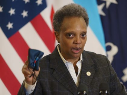 Mayor Lori Lightfoot emphasizes the importance of wearing a mask as she provides an update about the COVID-19 vaccinations at Norwegian American Hospital in Chicago on Tuesday, Jan. 5, 2021. (Youngrae Kim/Chicago Tribune via AP, Pool)