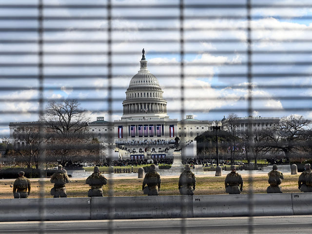 US National Guard troops stand in the vicinity of the US Capitol near high fences as the Inauguration of US President-Elect Joe Biden in Washington, DC begins on January 20, 2021. (Photo by ROBERTO SCHMIDT / AFP) (Photo by ROBERTO SCHMIDT/AFP via Getty Images)