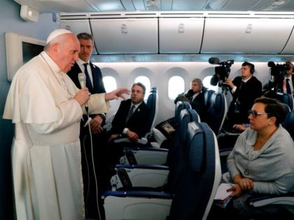 Pope Francis (L) speaks to reporters during a news conference onboard the papal plane on his flight back from a week-long trip to Thailand and Japan, on November 26, 2019. (Photo by REMO CASILLI / POOL / AFP) (Photo by REMO CASILLI/POOL/AFP via Getty Images)
