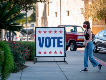 A voter walks toward a polling location on election day in Austin, Texas on November 3, 2020. - Americans were voting on Tuesday under the shadow of a surging coronavirus pandemic to decide whether to reelect Republican Donald Trump, one of the most polarizing presidents in US history, or send …