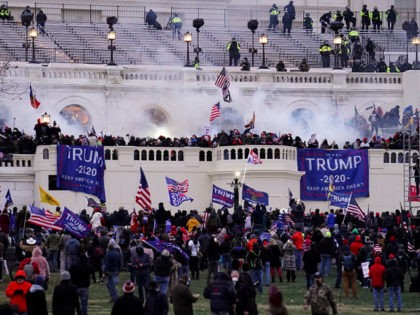 Violent protesters, loyal to President Donald Trump, storm the Capitol, Wednesday, Jan. 6, 2021, in Washington. It's been a stunning day as a number of lawmakers and then the mob of protesters tried to overturn America's presidential election, undercut the nation's democracy and keep Democrat Joe Biden from replacing Trump …