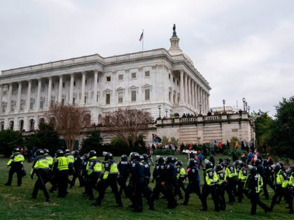 Riot police walk outside the US Capitol as supporters of US President Donald Trump protest on January 6, 2021, in Washington, DC. - Demonstrators breeched security and entered the Capitol as Congress debated the a 2020 presidential election Electoral Vote Certification. (Photo by ALEX EDELMAN / AFP) (Photo by ALEX …