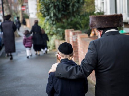 LONDON, ENGLAND - JANUARY 17: Members of the Jewish community walk along the street in the Stamford Hill area on January 17, 2015 in London, England. Police have announced they will increase patrols in areas with large Jewish communities such as London and Manchester in response to last week's Paris …