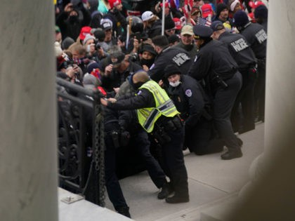 U.S. Capitol Police try to hold back protesters outside the U.S. Capitol, Wednesday, Jan 6, 2021. (AP Photo/Andrew Harnik)