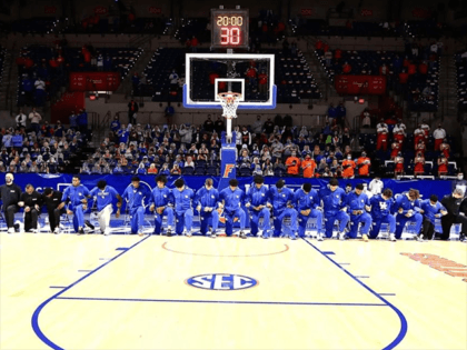 University of Kentucky men's basketball team takes a knee during National Anthem on January 9, 2021