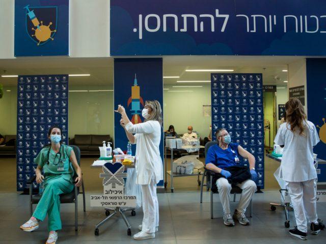 TEL AVIV, ISRAEL - DECEMBER 20: Medical workers vaccinate medical stuff members against Coronavirus disease(COVID-19) at Tel Aviv Sourasky Medical Center as Israel starts the COVID 19 vaccination campaign on December 20, 2020 in Tel Aviv, Israel. On Saturday night, Prime Minister Benjamin Netanyahu became the first Israeli to receive …