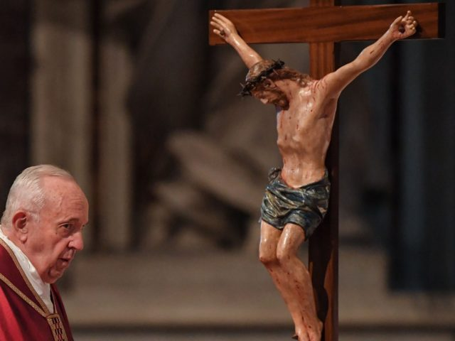 Pope Francis watches a crucifix during the Celebration of the Lord's Passion on Good Friday at St Peter's Basilica, on April 19, 2019 in the Vatican. - Christians around the world are marking the Holy Week, commemorating the crucifixion of Jesus Christ, leading up to his resurrection on Easter. (Photo …