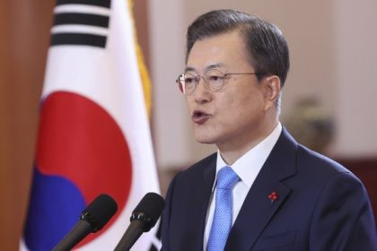 South Korean President Moon Jae-in speaks during his New Year's address at the presidential Blue House in Seoul, South Korea, Monday, Jan. 11, 2021. Moon said it'll offer COVID-19 vaccinations to all its people free of charge in phased steps. (Choi Jae-gu/Yonhap via AP)
