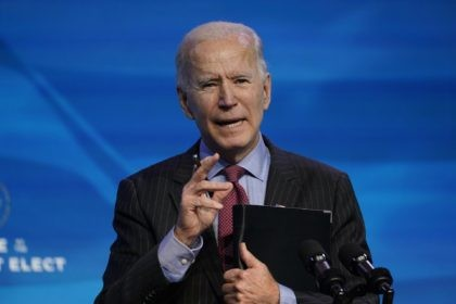 In this Jan. 8, 2021, file photo, President-elect Joe Biden speaks during an event at The Queen theater in Wilmington, Del. A coronavirus action plan fromBiden centers on a mass vaccination campaign and closer coordination among all levels of government. The Biden plan comes as a divided nation remains caught …