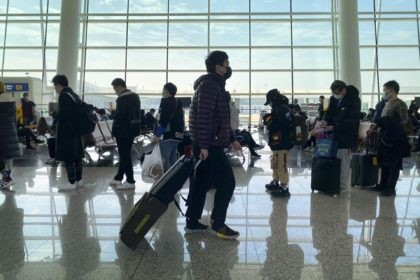 Passengers wearing face masks to protect against the spread of the coronavirus line up at a boarding gate at Wuhan Tianhe International Airport in Wuhan in central China's Hubei Province, Thursday, Jan. 14, 2021. China is seeing a new surge in coronavirus cases in its frozen northeast as a World …
