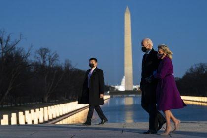 President-elect Joe Biden and his wife Jill Biden leave a COVID-19 memorial event at the Lincoln Memorial Reflecting Pool, Tuesday, Jan. 19, 2021, in Washington. (AP Photo/Evan Vucci)