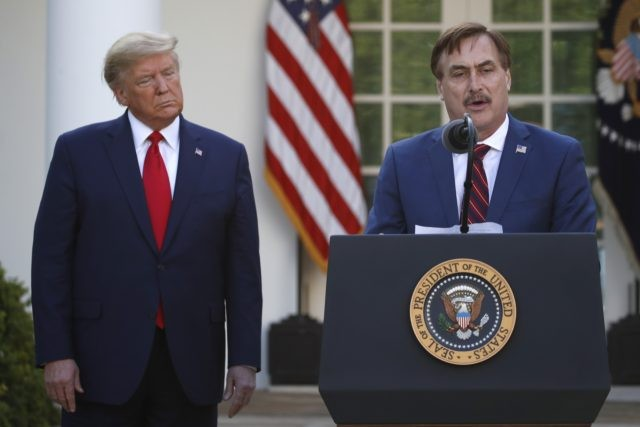 In this March 30, 2020 file photo, My Pillow CEO Mike Lindell speaks as President Donald Trump listens during a briefing about the coronavirus in the Rose Garden of the White House, in Washington. Lindell, an avid supporter of President Donald Trump, who has continued to push the notion of …