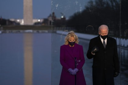 President-elect Joe Biden and his wife Jill Biden participate in a COVID-19 memorial event at the Lincoln Memorial Reflecting Pool, Tuesday, Jan. 19, 2021, in Washington. (AP Photo/Evan Vucci)