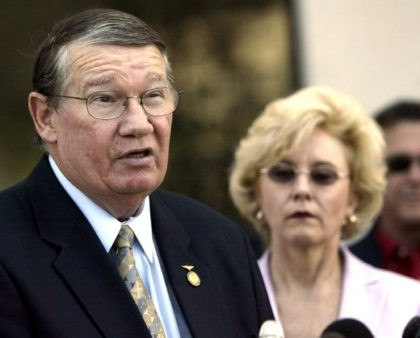 """In this July 14, 2005, file photo, then-Rep. Randy """"Duke"""" Cunningham, flanked by his wife Nancy, announces he will not seek re-election, during a news conference in San Marcos, Calif. When Rep. Cunningham admitted in 2005 to accepting $2.4 million in illegal gifts from defense contractors in exchange for government …"""