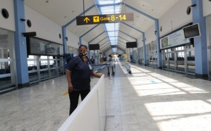 A Sri Lankan airport worker arranges a partition inside a terminal at the Katunayake International Airport in Colombo, Sri Lanka, Wednesday, Jan. 20, 2021. Sri Lanka's tourism minister said that the airports in the country will be reopened for tourists according to health guidelines from Jan.21. (AP Photo/Eranga Jayawardena)