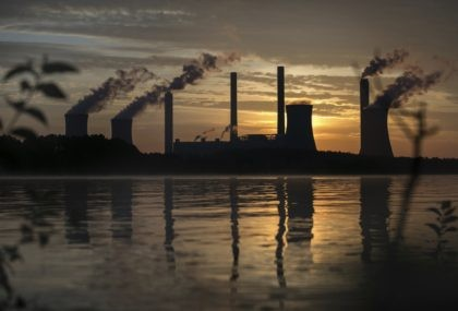 In this Saturday, June, 3, 2017 file photo, the coal-fired Plant Scherer, one of the nation's top carbon dioxide emitters, stands in the distance in Juliette, Ga.. World leaders breathed an audible sigh of relief that the United States under President Joe Biden is rejoining the global effort to curb …
