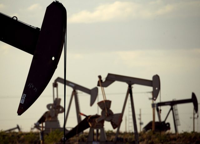 In this April 24, 2015, file photo, pumpjacks work in a field near Lovington, N.M. In the closing months of the Trump administration, energy companies stockpiled enough drilling permits for western public lands to keep pumping oil for years. That stands to undercut President-elect Joe Biden's plans to block new …