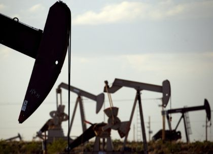 In this April 24, 2015, file photo, pumpjacks work in a field near Lovington, N.M. Oil and gas development infused $2.8 billion into New Mexico coffers during the 2020 fiscal year and marked its second-highest total revenue ever reported despite a global price war and plummeting demand amid the coronavirus …