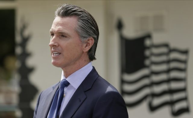 In this Friday, May 22, 2020, file photo, California Gov. Gavin Newsom speaks during a news conference at the Veterans Home of California in Yountville, Calif. A federal appeals court has denied a Southern California church's request to overturn the state's coronavirus restrictions barring worship services indoors during the coronavirus …