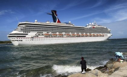 In this March 9, 2020 photo, the Carnival Liberty leaves Port Canaveral, Fla. Carnival Cruise Line said Monday, Jan. 25, 2021, is cancelling and delaying more U.S. sailings as it continues to suffer from the pandemic's fallout. (Joe Burbank/Orlando Sentinel via AP, File)
