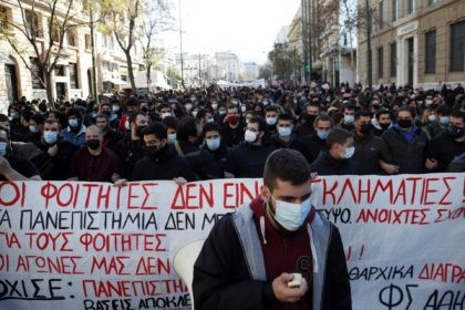 """University students gather during a rally against educational reforms as the banner reads """"The students are not criminals"""" in Athens, Thursday, Jan. 21, 2021. About 1,500 students took part in two separate protests against government's plans to set up a state security division at university campuses and time limits set …"""