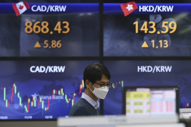 A currency trader watches monitors at the foreign exchange dealing room of the KEB Hana Bank headquarters in Seoul, South Korea, Thursday, Jan. 28, 2021. Asian shares skidded on Thursday as a reality check set in about longtime economic damage from the coronavirus pandemic, giving Wall Street its worst day …
