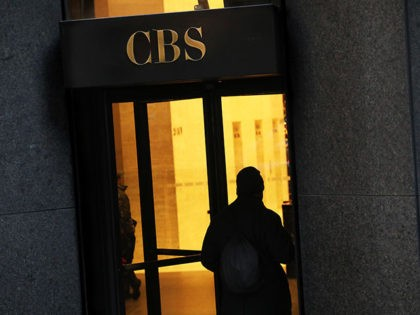 A man enters CBS headquarters, Thursday, Dec. 6, 2018, in New York. (AP Photo/Mark Lennihan)