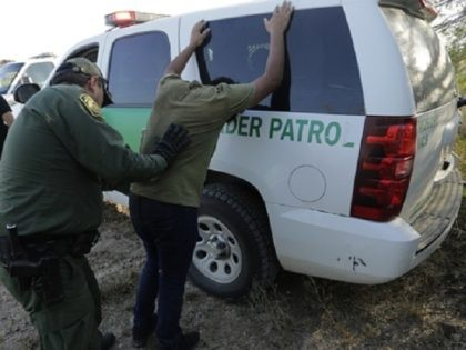 In this Wednesday, Nov. 6, 2019, photo, Border Patrol agents stop two men thought to have entered the country illegally, near McAllen, Texas, along the U.S.-Mexico border. In the Rio Grande Valley, the southernmost point of Texas and historically the busiest section for border crossings, the U.S. Border Patrol is …