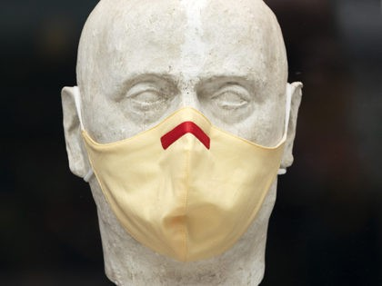 A men's clothing store mannequin has a mask, Thursday, Sept. 24, 2020 in New York. (AP Photo/Mark Lennihan)