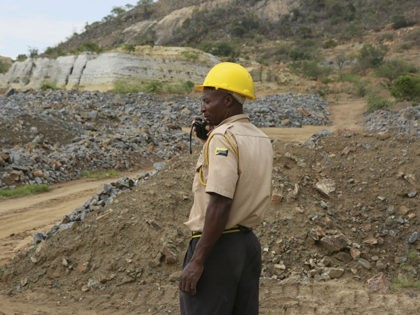 A security guard is seen near the sight of an abandoned mine where artisanal miners are trapped underground in Bindura about 70 kilometres northeast of the capital Harare, Tuesday, Dec, 1, 2020. Artisanal miners illegally digging for gold in a disused shaft blasted a support pillar resulting in them being …