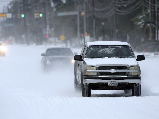 Vehicles drive on snow and sleet covered roads Monday, Feb. 15, 2021, in Spring, Texas. A winter storm dropping snow and ice sent temperatures plunging across the southern Plains, prompting a power emergency in Texas a day after conditions canceled flights and impacted traffic across large swaths of the U.S. …