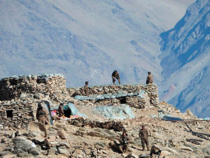 This photograph provided by the Indian Army, according to them shows Chinese troops dismantling their bunkers at Pangong Tso region, in Ladakh along the India-China border on Monday, Feb.15, 2021. China and India are pulling back front-line troops from disputed portions of their mountain border where they have been in …