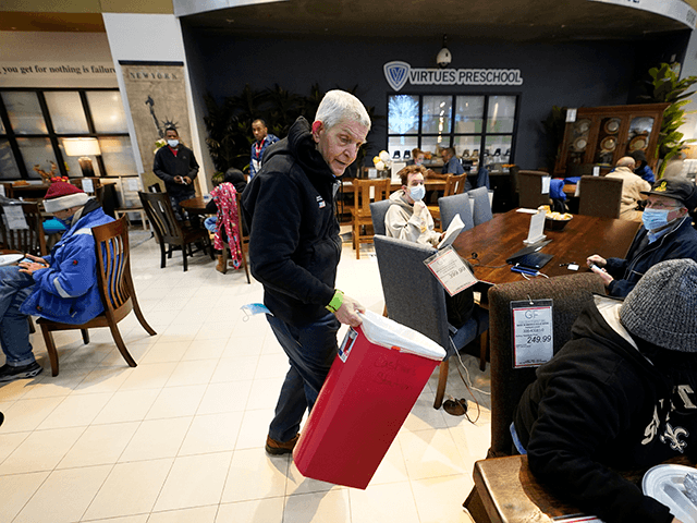 Owner Jim McIngvale collects trash inside his Gallery Furniture store which opened as a shelter Wednesday, Feb. 17, 2021, in Houston. Millions in Texas still had no power after a historic snowfall and single-digit temperatures created a surge of demand for electricity to warm up homes unaccustomed to such extreme …