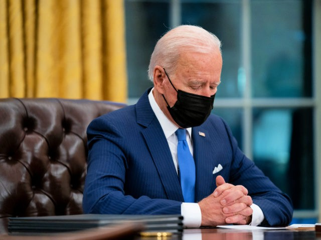 President Joe Biden looks down as he talks about the FBI agents killed in Sunrise, Fla., during an event on immigration in the Oval Office of the White House, Tuesday, Feb. 2, 2021, in Washington. (AP Photo/Evan Vucci)