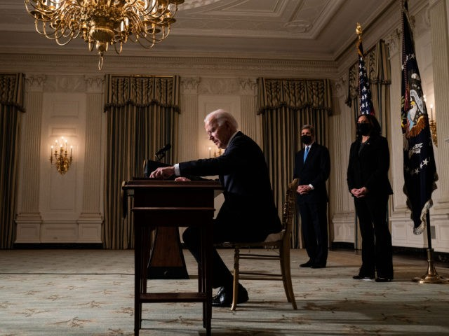 WASHINGTON, DC - JANUARY 27: U.S. President Joe Biden signs executive orders after speaking about climate change issues in the State Dining Room of the White House on January 27, 2021 in Washington, DC. President Biden signed several executive orders related to the climate change crisis on Wednesday, including one …