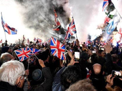 LONDON, ENGLAND - JANUARY 31: Pro Brexit supporters celebrates as the United Kingdom exits the EU during the Brexit Day Celebration Party hosted by Leave Means Leave at Parliament Square on January 31, 2020 in London, England. At 11.00pm on Friday 31st January the UK and Northern Ireland exits the …