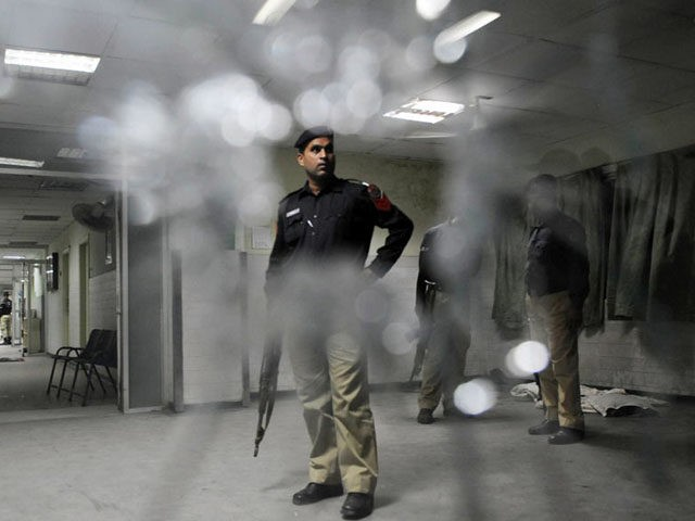 Pakistani policemen search a hospital following the gunmen attack at the Jinnah Hospital in Lahore on June 1, 2010. Gunmen opened fire at a Pakistan hospital where victims of attacks on Ahmadi mosques were being treated late May 31, killing 12 people in a shootout with security forces, a doctor …