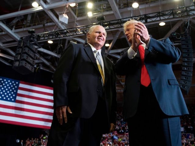 US President Donald Trump alongside radio talk show host Rush Limbaugh arrive at a Make America Great Again rally in Cape Girardeau, Missouri on November 5, 2018. (Photo by Jim WATSON / AFP) (Photo by JIM WATSON/AFP via Getty Images)
