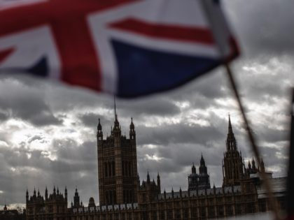 LONDON, ENGLAND - MARCH 13: A Union flag flies outside the Houses of Parliament on March 13, 2019 in London, England. Last night MPs voted 242 to 391 against British Prime Minister Theresa May's Brexit deal in the second meaningful vote. They will now vote today on whether the UK …