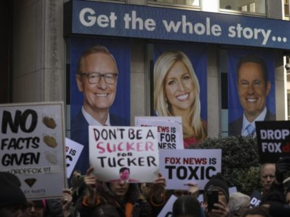 NEW YORK, NY - MARCH 13: Protesters rally against Fox News outside the Fox News headquarters at the News Corporation building, March 13, 2019 in New York City. On Wednesday the network's sales executives are hosting an event for advertisers to promote Fox News. Fox News personalities Tucker Carlson and …