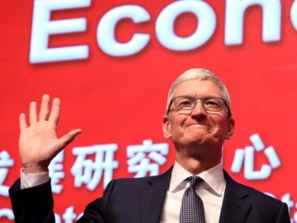 Apple CEO Tim Cook waves as he arrives for the Economic Summit held for the China Development Forum in Beijing on March 23, 2019. (Photo by Ng Han Guan / POOL / AFP) (Photo credit should read NG HAN GUAN/AFP via Getty Images)