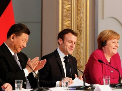 (From L) Chinese President Xi Jinping, French President Emmanuel Macron and German Chancellor Angela Merkel hold a press conference at the Elysee presidential palace in Paris, on March 26, 2019. - Xi Jinping meets with the leaders of France, Germany and the European Commission, as European countries seek to boost …